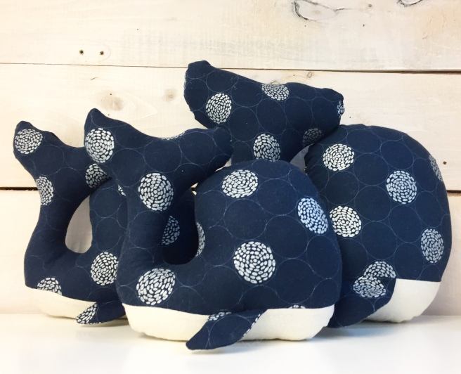 Navy and cream cotton whale soft toy, stuffed animal.